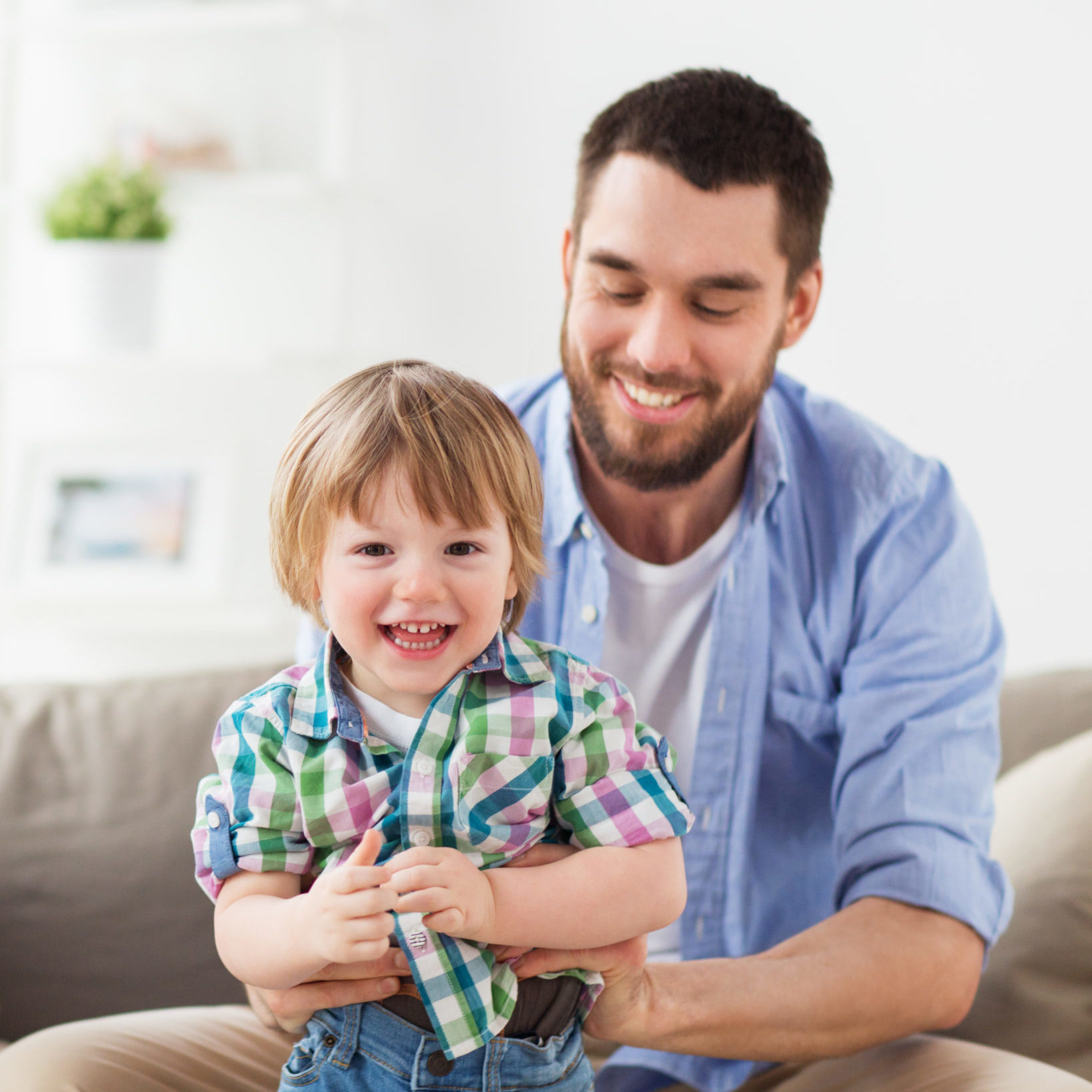 family and people concept - happy father with little son at home